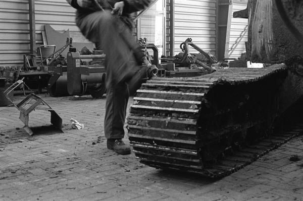 Man + Machine / foot on caterpillar track